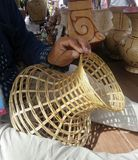 Craftman making vase basketry. Handmade craft by bamboo in Banchiang village , Northeast Thailand Royalty Free Stock Images