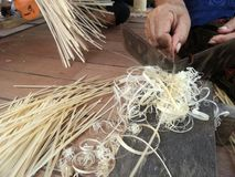 Craftman preparing bamboo for basketry work. Folk art and craft product and household from natural resources . This delicate craft require great patience Stock Image