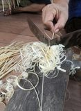 Craftman preparing bamboo for basketry work Royalty Free Stock Photo