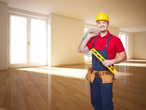 Craftman service. Portrait of caucasian handyman in empty flat Stock Image