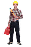 Craftman with spirit-level. And tool box Stock Images