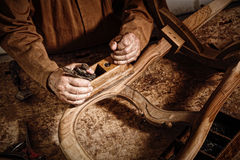 Craftman at work. Detail of senior carpenter at work Stock Images