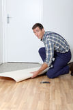 Craftmanship. Closeup of artisan installing ground floor in room royalty free stock photography