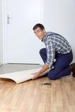 Craftmanship. Closeup of artisan installing ground floor in room Royalty Free Stock Photography