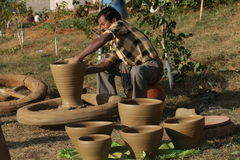 Craftmanship. Craftsman making pot with mud royalty free stock photo
