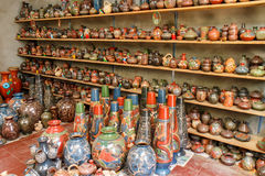 Craftmanship, handmade ceramics from a shop. Handmade ceramic crafts group from a shop stock image