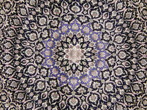 Crafts. Central part of an old carpet with an oriental pattern. Background. Exhibition Household Expo, Moscow. March, 2014 royalty free stock image