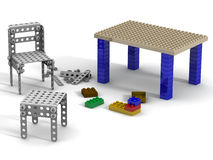Crafts from the designer. Chair and table collected from children's designer and details of the building kit on a white surface. . 3D Illustration Royalty Free Stock Photo