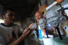 Crafts Dolls world and cartoon characters. Craftsmen finish sketching the face of world leaders to serve as miniature dolls in Solo, Central Java, Indonesia royalty free stock images