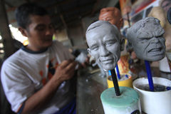 Crafts Dolls world and cartoon characters. Craftsmen finish sketching the face of world leaders to serve as miniature dolls in Solo, Central Java, Indonesia royalty free stock photo
