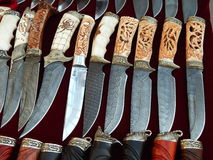 Crafts. Knives with decorative handles. Knives with decorative handles.International Trade Fairs GIFTS EXPO. AUTUMN 2014 - CHRISTMAS & FESTIVE DECORATIONS royalty free stock photo