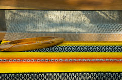 Crafts. Old weaving Loom and thread of yarn. Crafts. Hand loom with many colorful woolen threads royalty free stock image