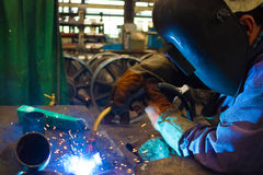 Crafts at the present time. Man welder working welding of pipes,photography Royalty Free Stock Images
