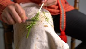 Crafts. View of boy cleans twig from bark. Close-up stock footage