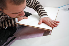 Craftsman. Workers laid laminate in home renovation Stock Image