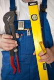 Craftsman. With water level and other tools Stock Photography
