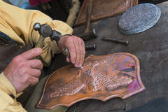 Craftsman affecting copper. Craftsman committed to affect the copper Royalty Free Stock Image