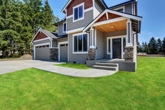Craftsman American house with rocks trim, garage and concrete floor porch. Classic large craftsman American house exterior with rocks trim, garage and concrete stock image