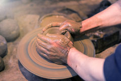Craftsman artist making craft, pottery, sculptor from fresh wet Stock Images