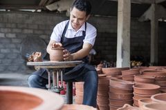 Craftsman artist making pottery Stock Photography
