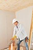 Craftsman as artisan cutting wood. At construction site Royalty Free Stock Image