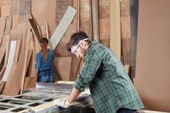 Craftsman as artisan processing wood. With machine Royalty Free Stock Images