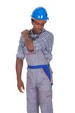 Craftsman with back pain. Young African Craftsman With Back Pain Isolated Over White Background Stock Image
