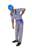 Craftsman With Back Pain. Young African Craftsman With Back Pain Isolated Over White Background Royalty Free Stock Photos