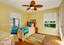 Craftsman bedroom interior with hardwood floor and rug. Stock Photos