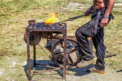 Craftsman at blacksmith forge. Royalty Free Stock Photo