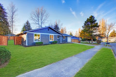Craftsman blue one-story low-pitched roof home in Tacoma. Royalty Free Stock Images