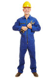 Craftsman in boiler suit holding jaw wrench Stock Image