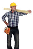 Craftsman carrying a board Royalty Free Stock Image
