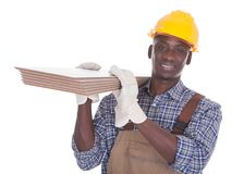 Craftsman carrying floor tiles Royalty Free Stock Photo