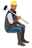 Craftsman carrying huge hammer Stock Image