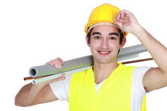 Carrying pipes on his shoulder Stock Photography
