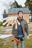Craftsman carrying wood. To construction site Royalty Free Stock Photography