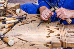 Craftsman carving Royalty Free Stock Images