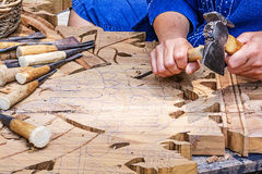 Craftsman carving Stock Photo