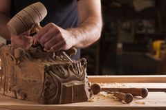 Craftsman carving wood royalty free stock image