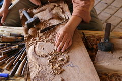 Craftsman carving wood Stock Image