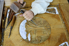 Craftsman carving wood Thai style. Royalty Free Stock Photography