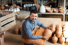 Craftsman with ceramic crockery Royalty Free Stock Image