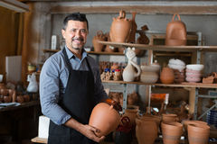 Craftsman with ceramic crockery Stock Photography