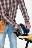 Craftsman with chainsaw Royalty Free Stock Images