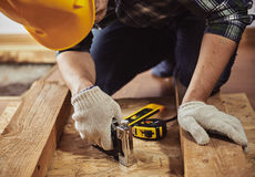 Craftsman with construction tools Stock Images