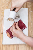 Craftsman corrects stamping of leather pouch. Leathercrafting - craftsman corrects stamping of handmade leather pouch Royalty Free Stock Image