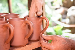 Craftsman creating new pottery cup Stock Photos