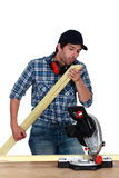 Craftsman cutting a board Stock Photography