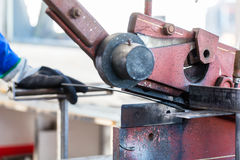 Craftsman cutting Metal with shear Royalty Free Stock Photos